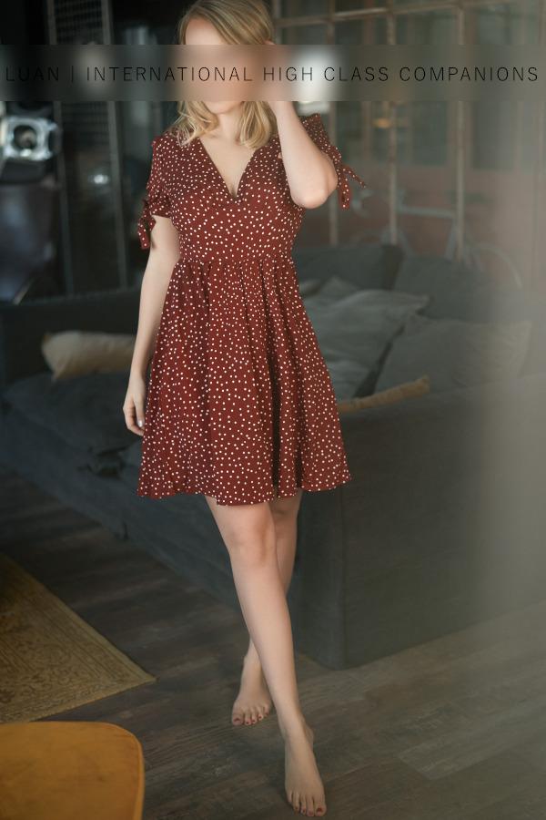 Elegant Escortlady in a red dress