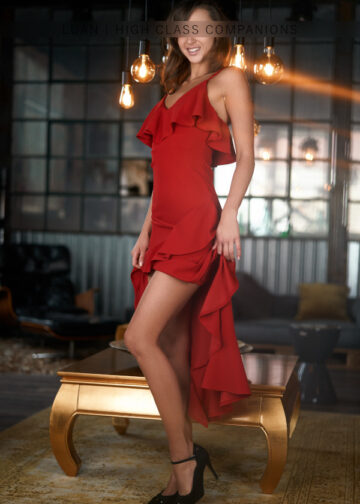 Elite Companion in a red dress