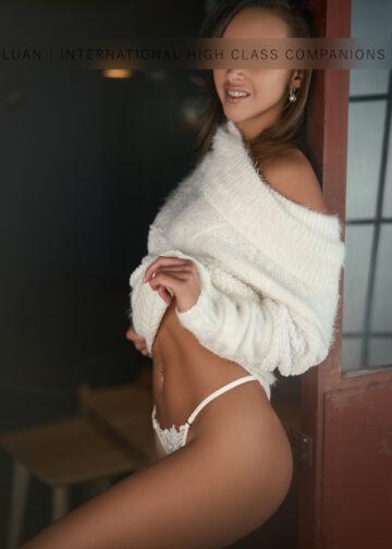 Escortgirl in a white sweater
