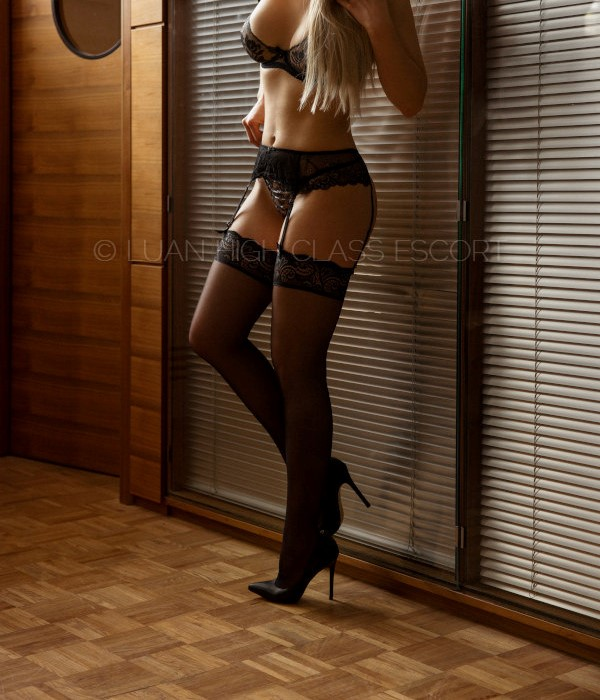 Sexy Escort Lady in Stockings