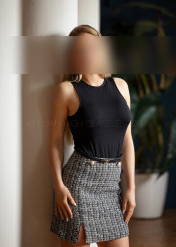 Elegant Escort in a business skirt