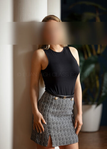 Elegant Elite Escort in a business outfit